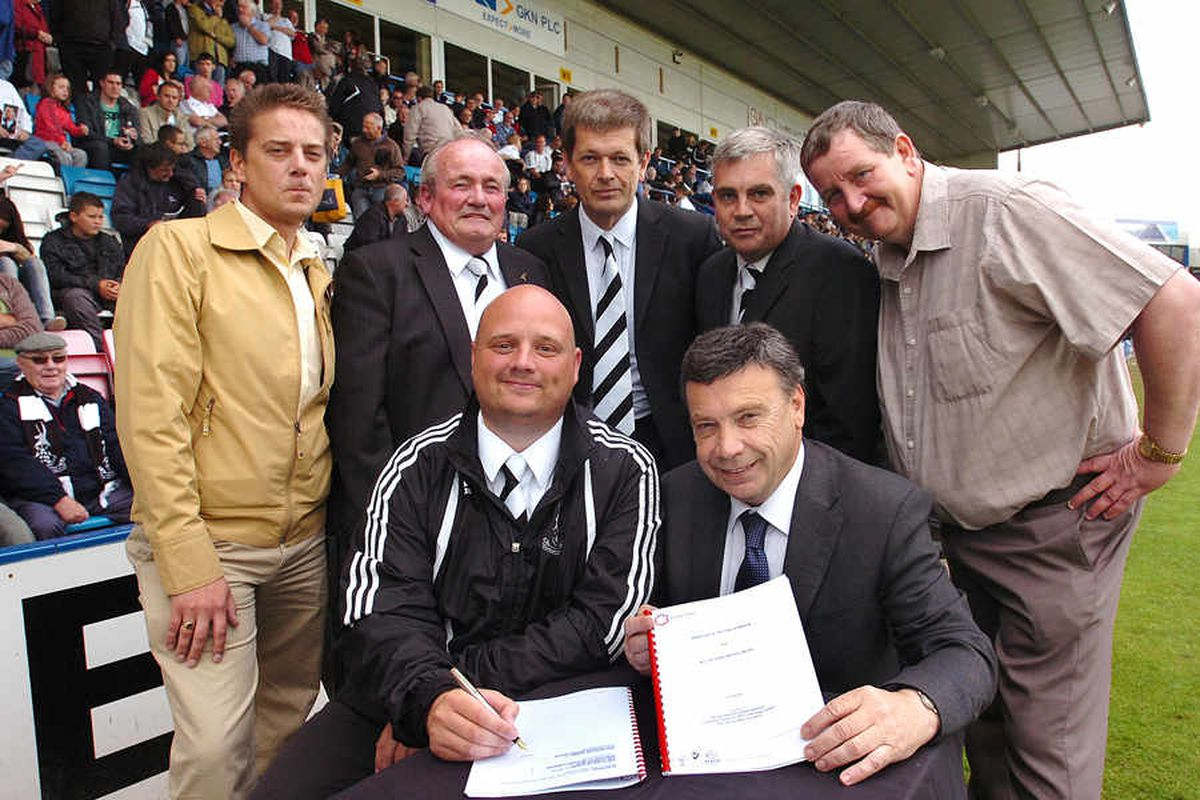 Club's fresh start – Lee Carter, front, signs the new 150-year lease with Telford and Wrekin Council