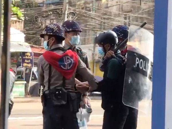 Associated Press journalist Thein Zaw is arrested by police in Yangon
