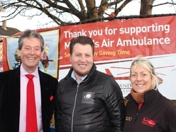 Car wash scrubs up for charity