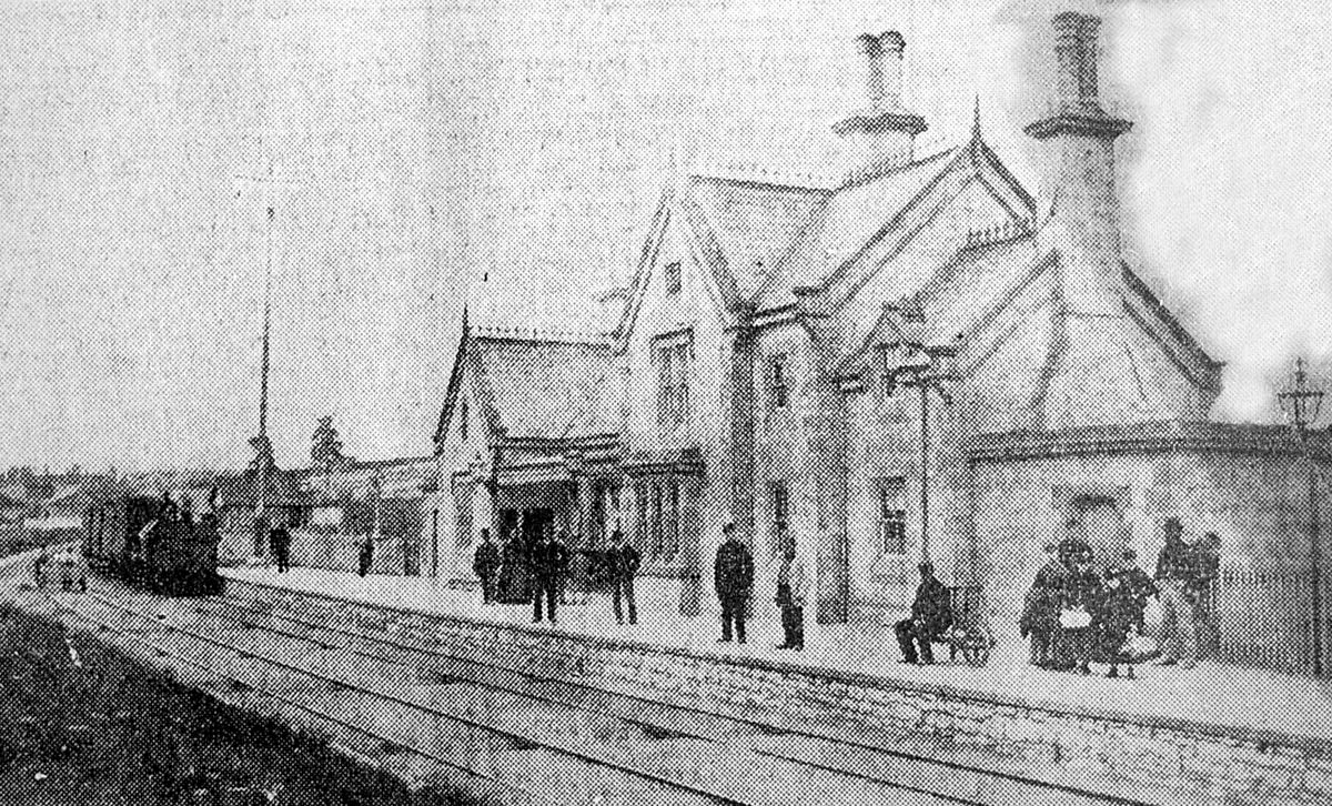 A poor quality photo showing Much Wenlock station in 1868. Among the figures on the platform are Mr Joseph Waller, Mr Ruscoe (first stationmaster), Mr John Yapp (signalman) and Mr Brookfield (booking clerk).