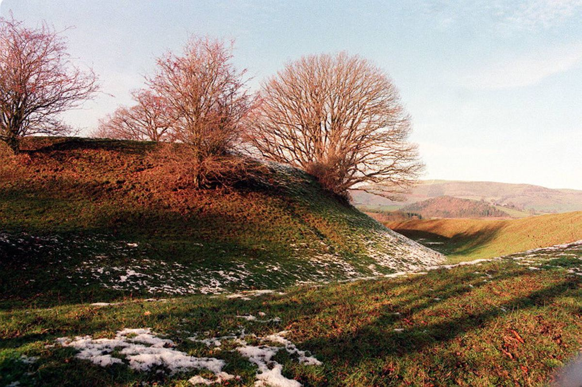 No, it's not just a few bumps in the ground and some frost. This is Welsh history. This picture from December 1995 shows Sycharth, near Llansilin, the 14th century home of Owain Glyndwr, who fought for Welsh independence. It was burnt down in 1403. Glyndwr simply disappeared and it is not known what became of him.