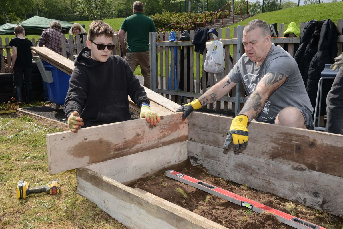Pupils, staff and volunteers help to create the outdoor classroom