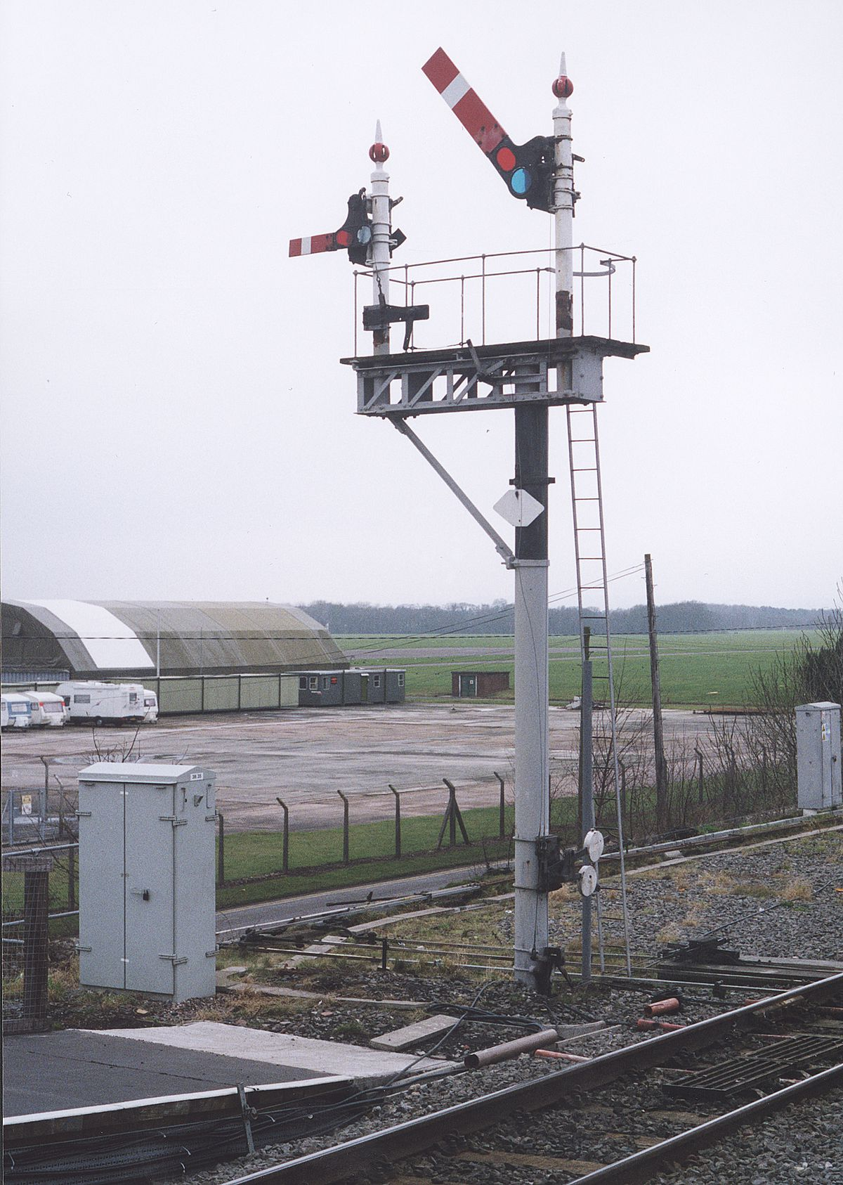 On the way out... semaphore signals at Cosford station in 2006 shortly before being replaced.