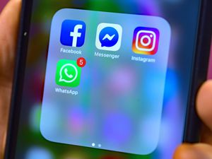 Stock photo of Facebook, Messenger, Instagram and WhatsApp social media app icons on a smart phone