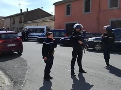 Two dead in supermarket hostage-taking in France