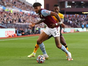 BIRMINGHAM, ENGLAND - OCTOBER 16: Tyrone Mings of Aston Villa is challenged by Nelson Semedo of Wolverhampton Wanderers during the Premier League match between Aston Villa and Wolverhampton Wanderers at Villa Park on October 16, 2021 in Birmingham, England. (Photo by Jack Thomas - WWFC/Wolves via Getty Images).