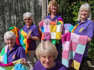 Newport Rotary Lite Knitters Felicity Barlow, Jane Dean, Liz Chesters (front), Tina Dean and Sandra Crabb with just some of the 150 blankets they and friends have knitted for dementia patients at PRH