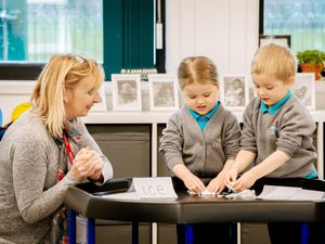 Mrs Hilditch helps young Thea Healey and Noah Edwards, both aged four, with their hands-on learning during a lesson at Tilstock Primary School in Whitchurch