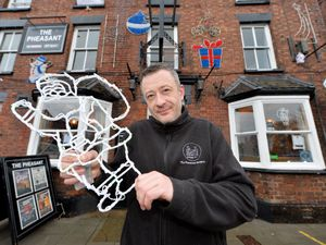 LAST COPYRIGHT TIM STURGESS SHROPSHIRE STAR...... 20/01/2021.   Dave Trigg at the Pheasant in Newport was one of the winners of the annual Christmas window display and he hasn't yet taken them down..