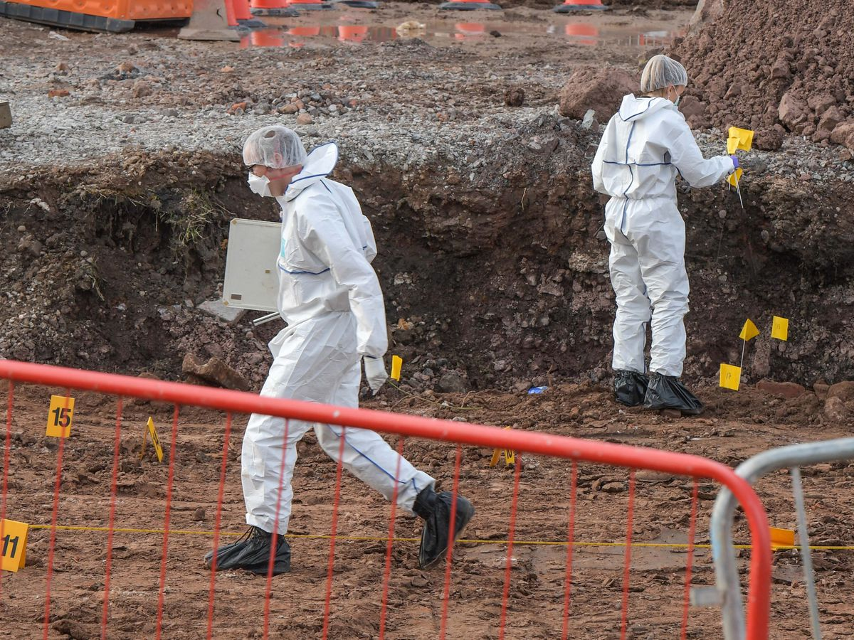 Police and forensics at the scene in Old Damson Lane in Solihull where human remains have been found. Photo: Snapper SK