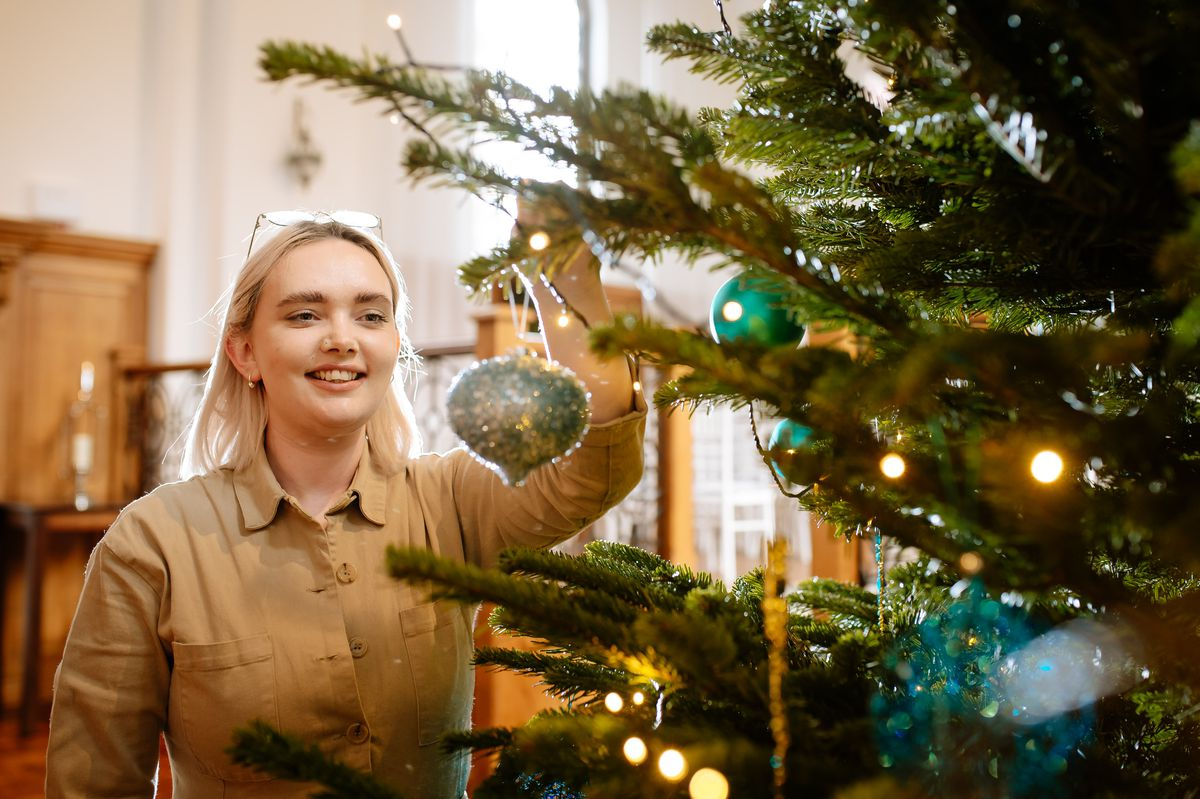Carly Roberts dresses the Christmas tree in the Chapel