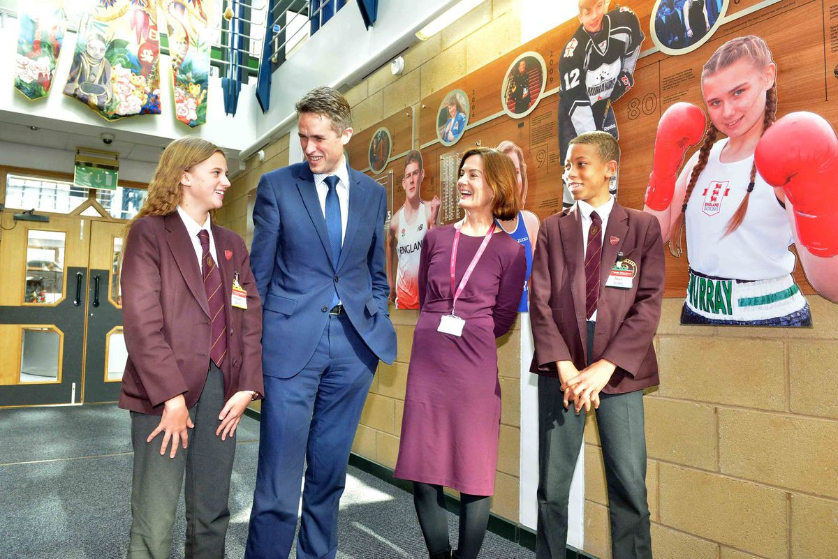 Telford MP Lucy Allan and Education Secretary Gavin Williamson in Thomas Telford School's corridor of fame with pupils Imogen West, 12, and Abel Bello,13
