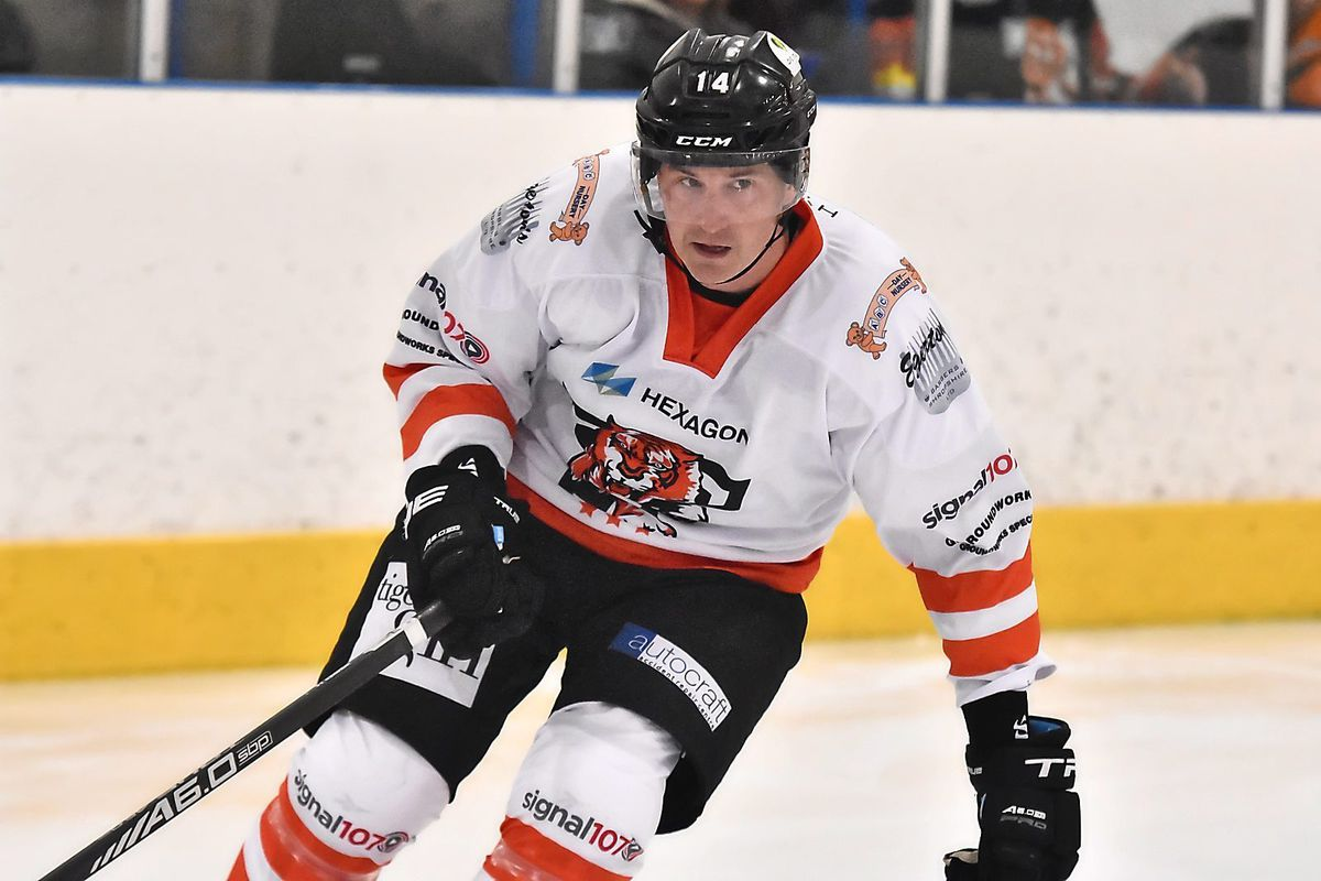 Telford Tigers' experienced defenceman Jonathan Weaver returned from a concussion to help his side to a league and cup double