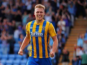 Sam Cosgrove of Shrewsbury Town celebrates after scoring a goal to make it 2-1.