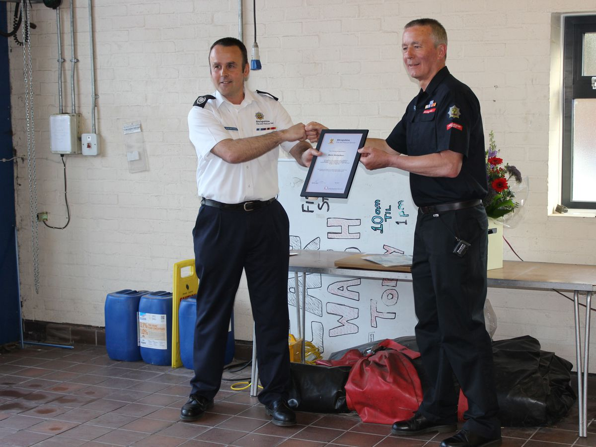 Shropshire Fire & Rescue Service group manager Adam Matthews with Martin Richardson