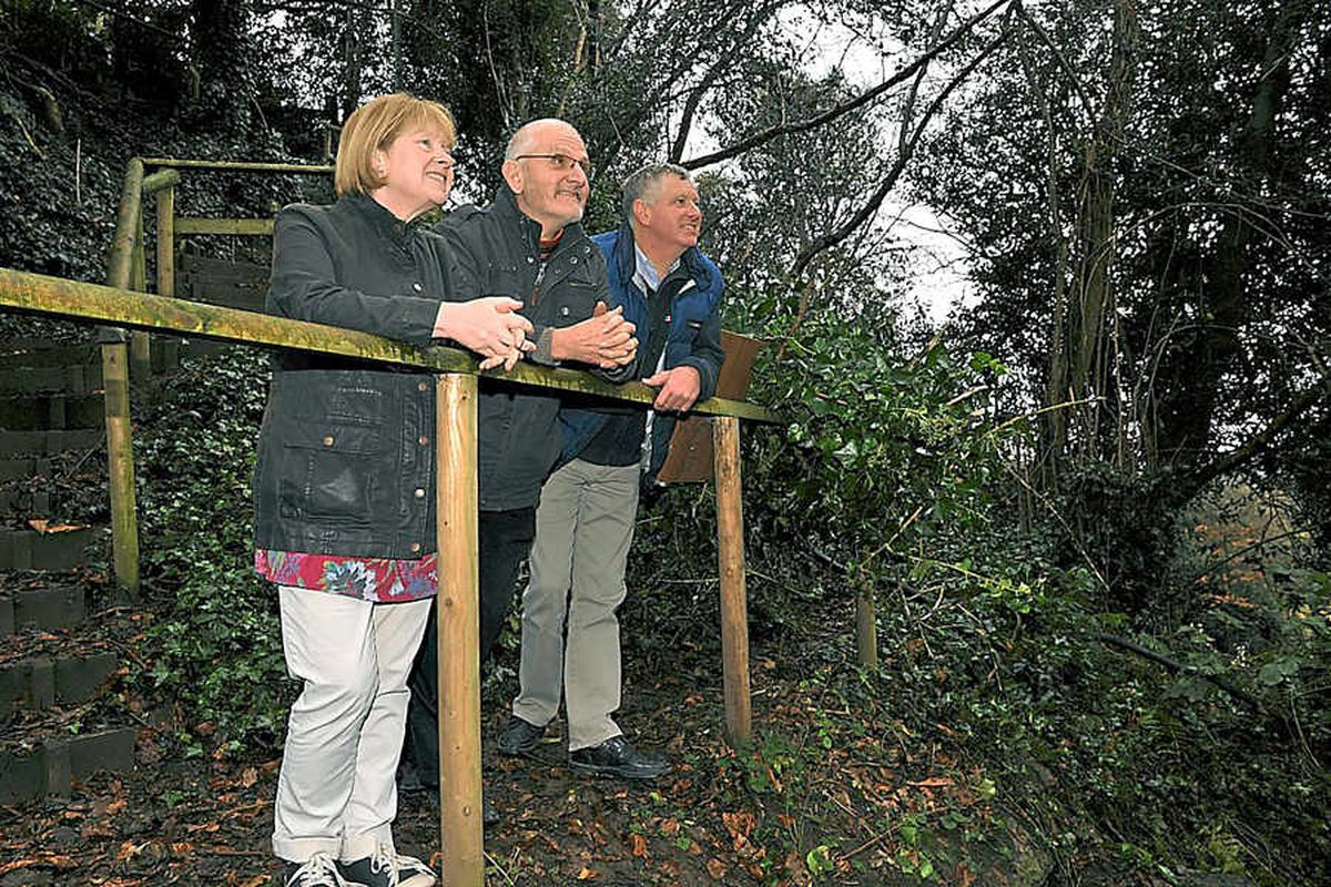 Celebrating the trust taking over Charles Darwin's childhood gardens are Sharon and John Leach and John Hughes