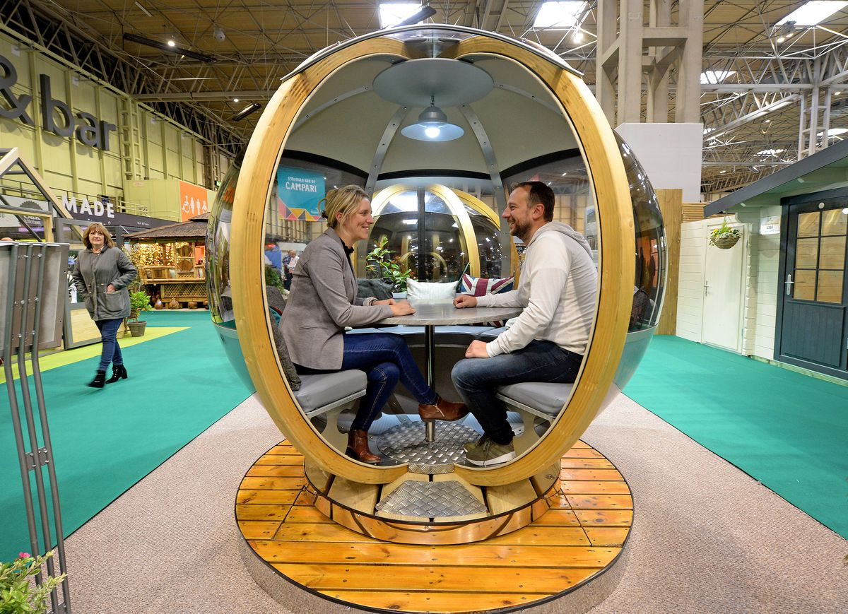 Vicky and Rob Osborne tries out the Ornate Garden rotating garden seat