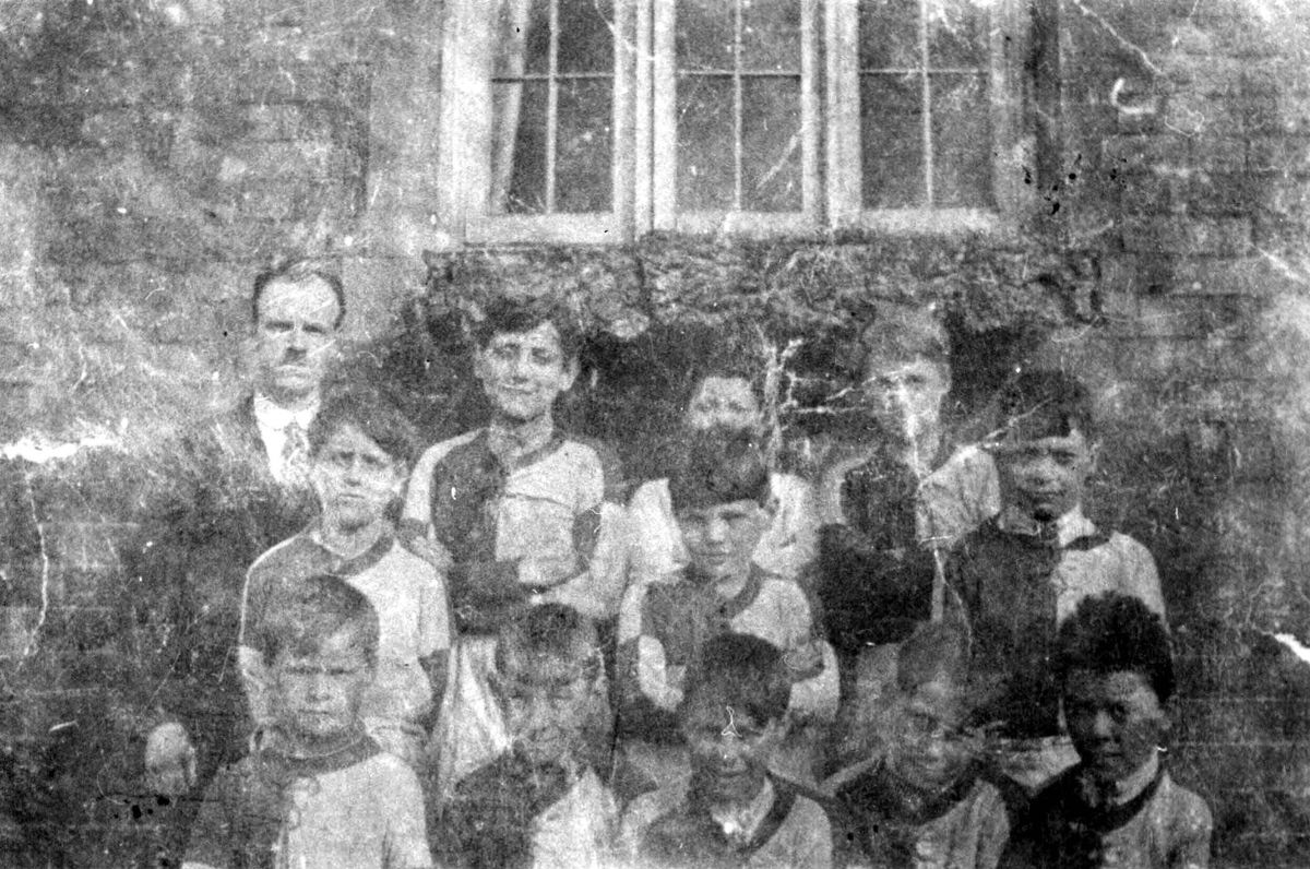 A very faded picture of the Ironbridge Blue School football team of 1925, which included Eustace Rogers of the town's famous coracle making family. Back, from left: Johnny Wragg (headmaster), Cyril Beeston (left back), Jack Jones (goalkeeper), Jack Tanner (right back). Middle row, from left: Cyril Rickers (left half), Ron Jones (centre half), Vic Duckett (right half). Front row from left: Charlie Jones (outside left), Eustace Rogers (inside left), George Jenks (centre forward), Norman Peel (inside Right), Jack Mason (outside right).
