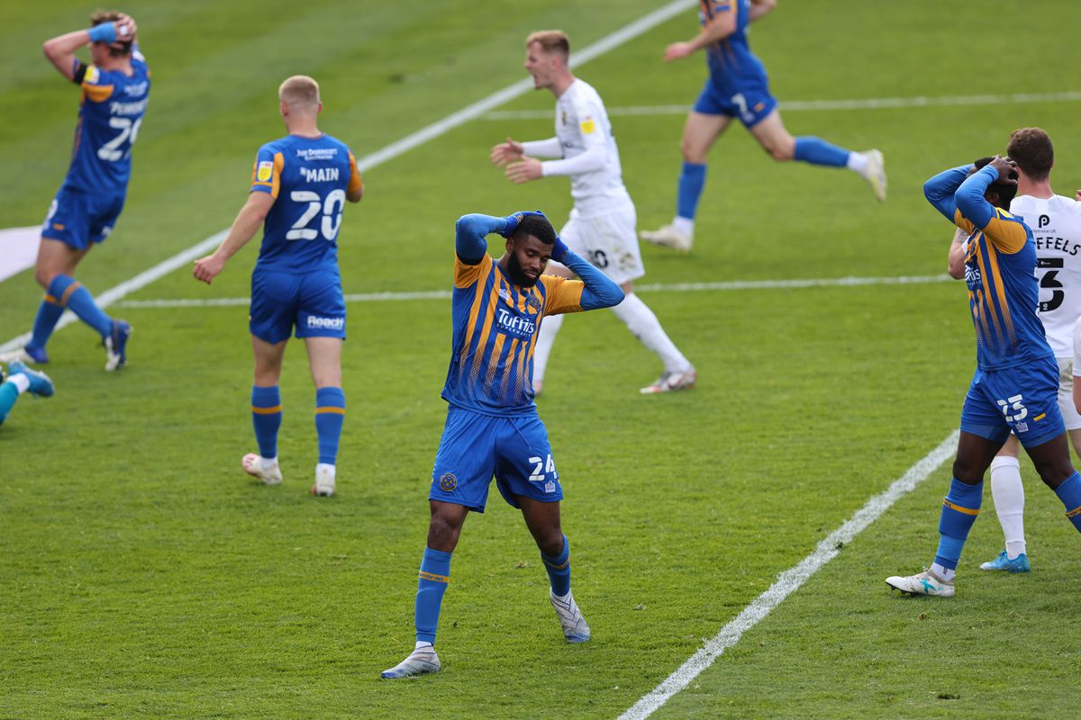 Ethan Ebanks-Landell of Shrewsbury Town reacts after his effort was saved during added time. (AMA)