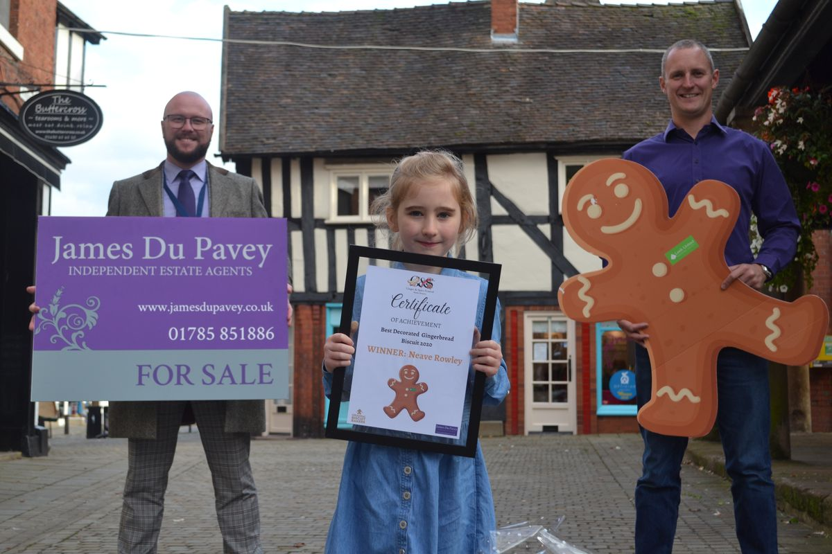 Gingerbread competition winner Neave Rowley with Lee Davies, left, and James Du Pavey of the James Du Pavey estate agents