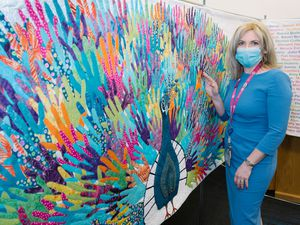 Victoria Sugden, League of Friends Charity Director, with the mural