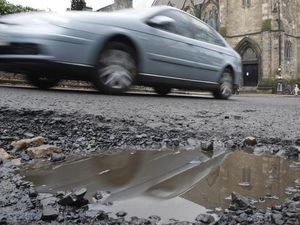 Many drivers want to see potholes fixed rather than driverless cars (Danny Lawson/PA)