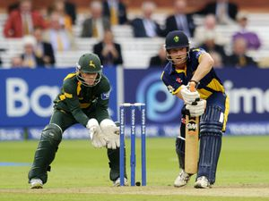 Glamorgan's Graham Wagg as Nottinghamshire's Chris Read watches on