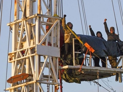 Fracking protesters brought to ground after climbing 60ft up rig