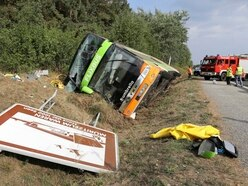 22 hurt as long-distance bus overturns on German motorway