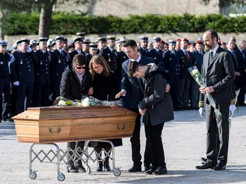 French policeman killed in extremist attack honoured in national tribute