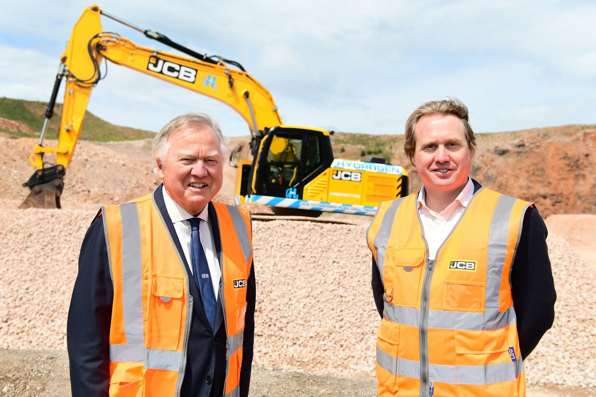 Lord Bamford and his son Jo pictured with a prototype JCB 220X excavator powered by a hydrogen fuel cell