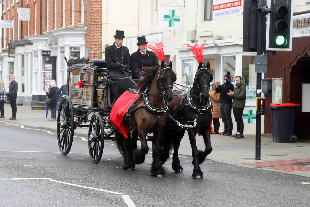 The funeral procession was seen by hundreds of people in Newport High Street. Photo: Paul Quinn