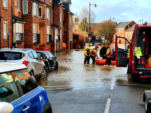 A boat rescue team in Chester Street, Shrewsbury. Pic: Owain Betts