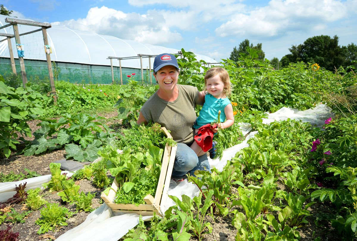 Daphne du Cros and her two-year-old daughter Isla at Little Woodbatch Farm near Bishop's Castle