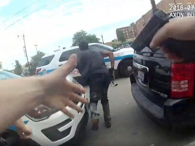 Footage shows man killed by Chicago police reached for waist