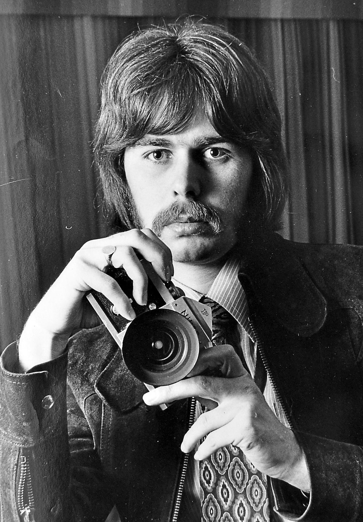 David Bagnall pictured as a young newspaper photographer in 1972