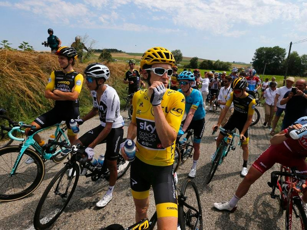 Tour de France interrupted by farmers' protest and police tear gas