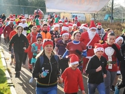 WATCH: Sea of Santas take over Telford Town Park for charity run