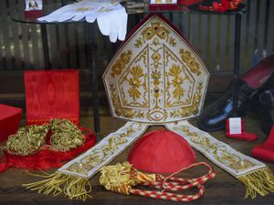 Cardinal clothing accessories are seen on display in the window of the Gammarelli clerical clothing shop, in Rome (Andrew Medichini/AP)