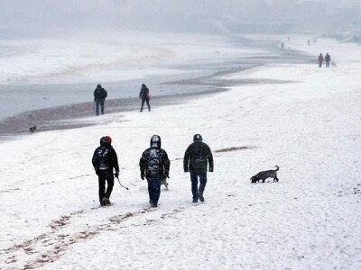 Snow flurries fall across parts of Britain