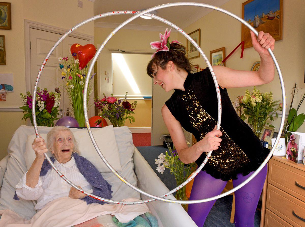 Gaynor Smith celebrates her 100th birthday at Hillcrest Manor Nursing Home, Minsterley, Shrewsbury, with activities co-ordinator Nula Irwin, aka Nula Hula, who gave Gaynor a personal hula hoop performance