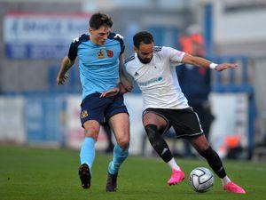 Brendon Daniels of Telford battles for the ball