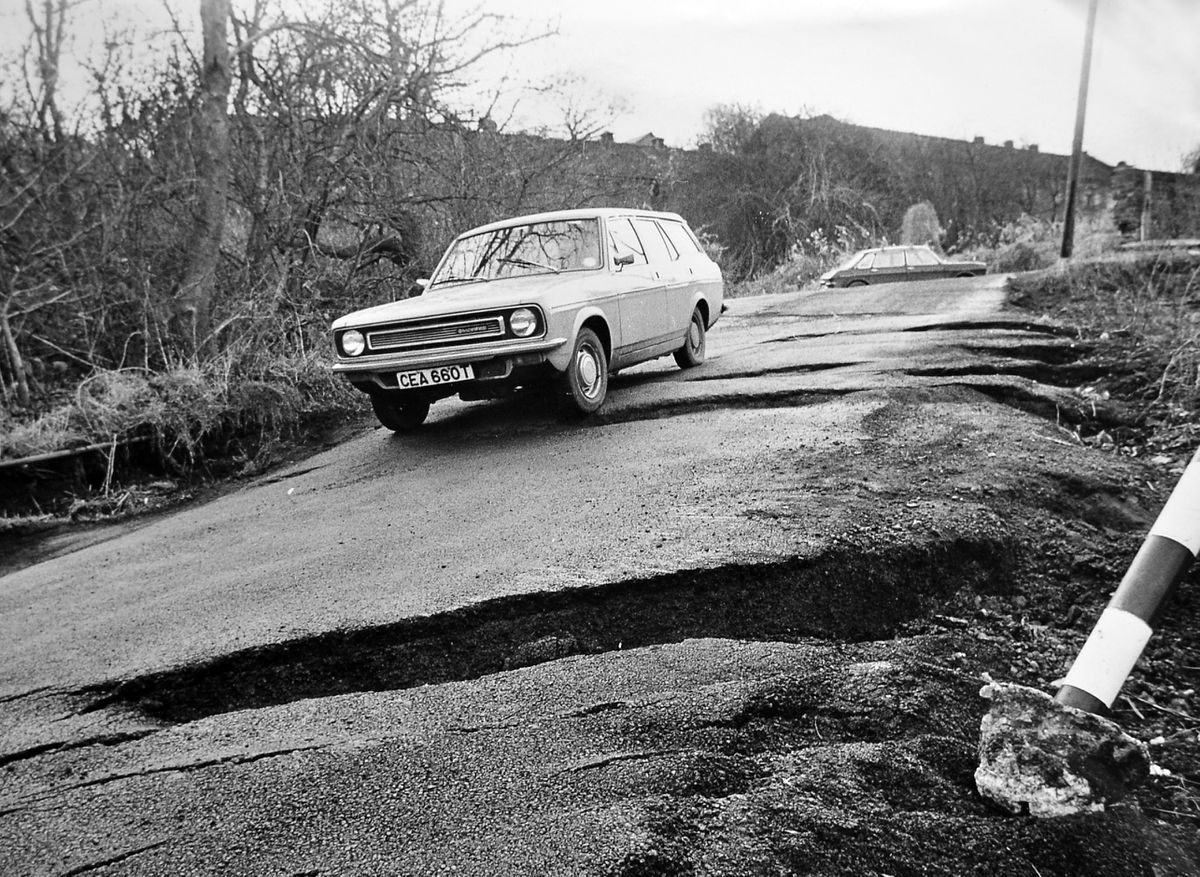 Part of Jackfield was cracking up in January 1983. The surface of this road had split open, a result of chronic subsidence problems in the area which have in recent times been addressed by a hugely expensive stabilisation scheme. The car taking its chances on this rocky road is a Morris Marina estate.