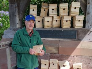 Fred Porton with dormouse boxes that he has made at a Shropshire church