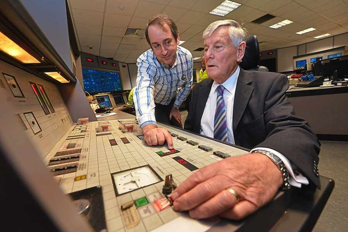 November 2015 - Pushing the buttons to shut down the power station are engineer Dave Glover and Mike Smith, who was invited back to turn the plant off after it was discovered he was the worker who turned it on in 1969