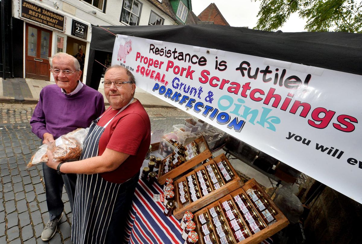 Checking out the pork scratchings is John Kelly, and Terry Parks from Gnosall is the man who runs the Willow Cottage stall