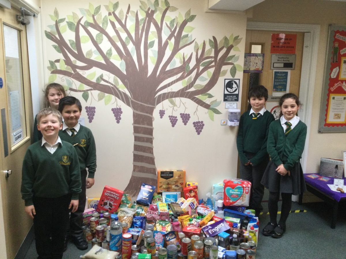Pupils from St John's Catholic Primary School with their food bank donations
