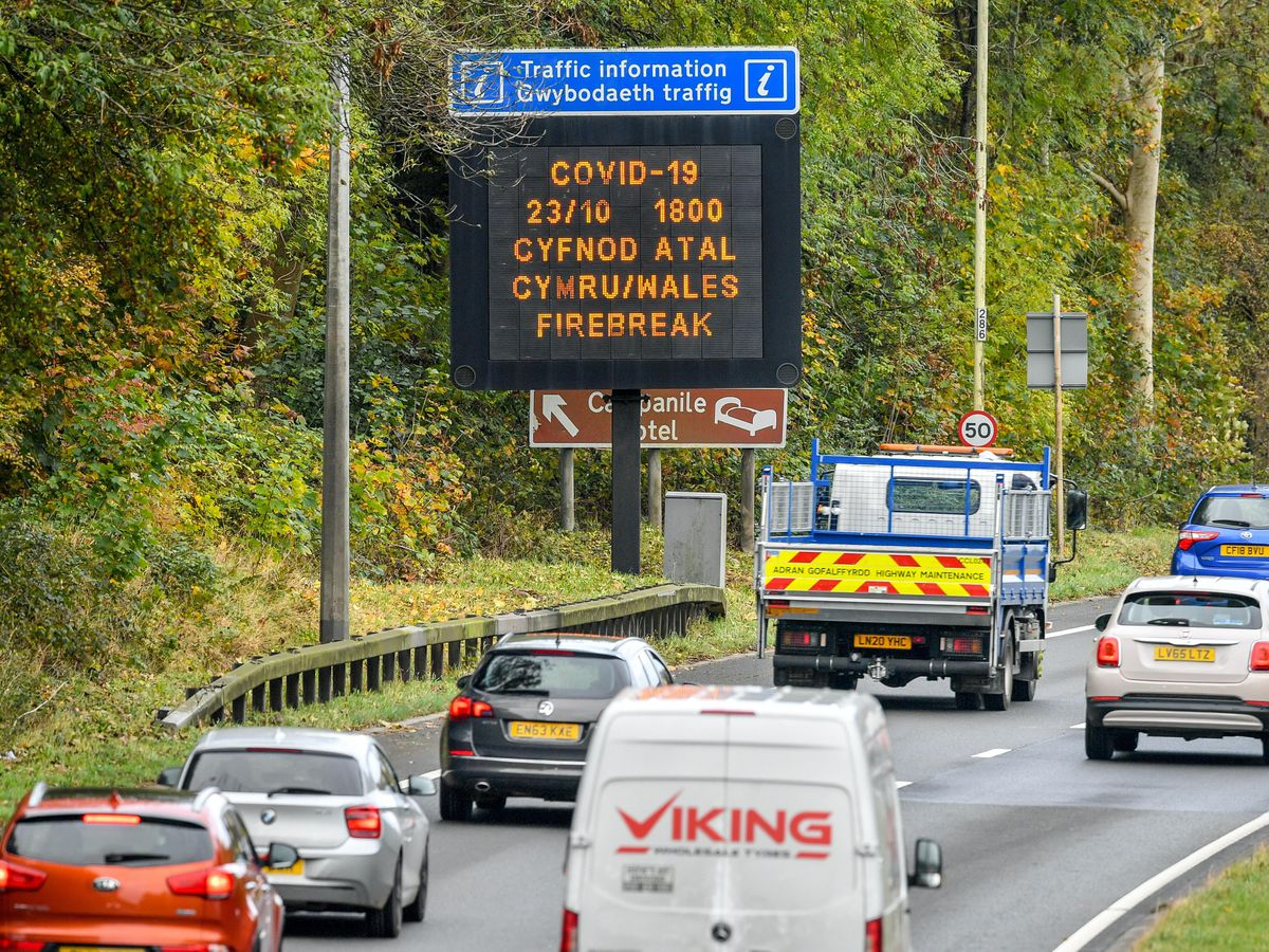 A sign on the A48(M) heading towards Cardiff informs motorists of Wales's fire-break lockdown