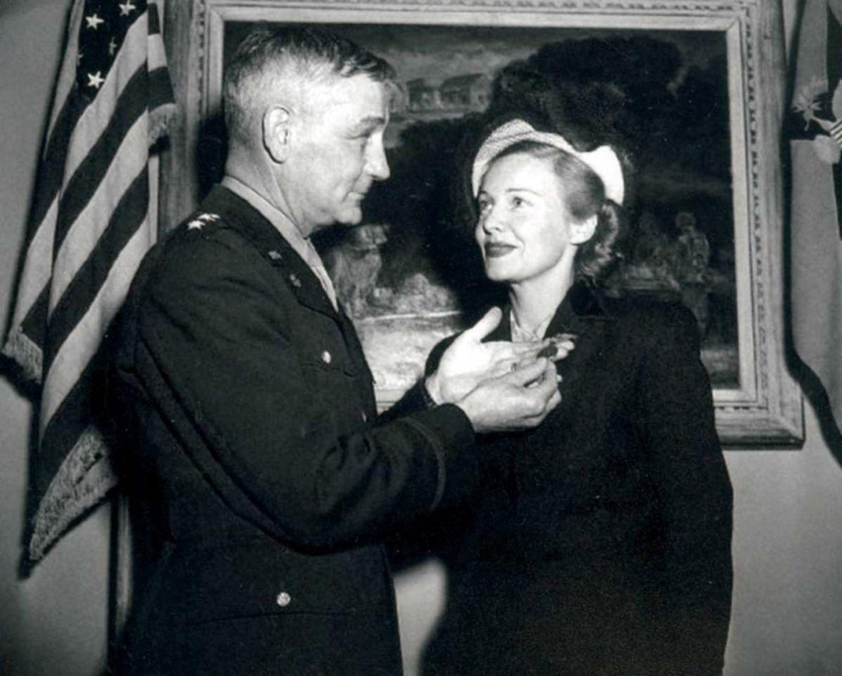Madeleine receiving her American Freedom Medal from Maj-Gen T B Larkin in 1946