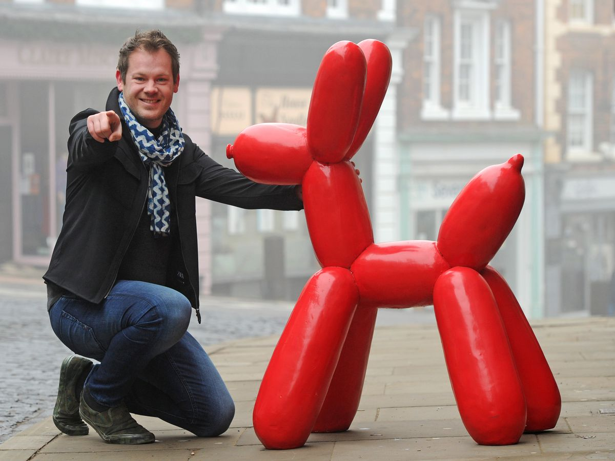 Jonathan Soden, owner of The Soden Collection art gallery, with 'Jeff', a sculpture inspired by artist Jeff Koons.